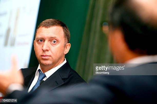 Oleg Deripaska founder and chief executive officer of United Co Rusal left participates in a discussion with Tony F Chan president of the Hong Kong...