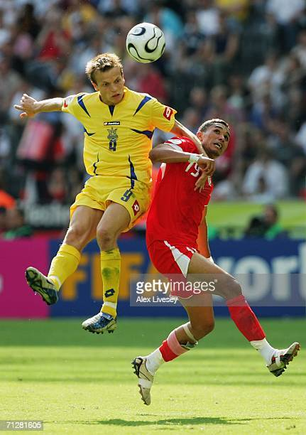 Oleg Gusev of Ukraine beats Anis Ayari of Tunisia to the ball during the FIFA World Cup Germany 2006 Group H match between Ukraine and Tunisia played...