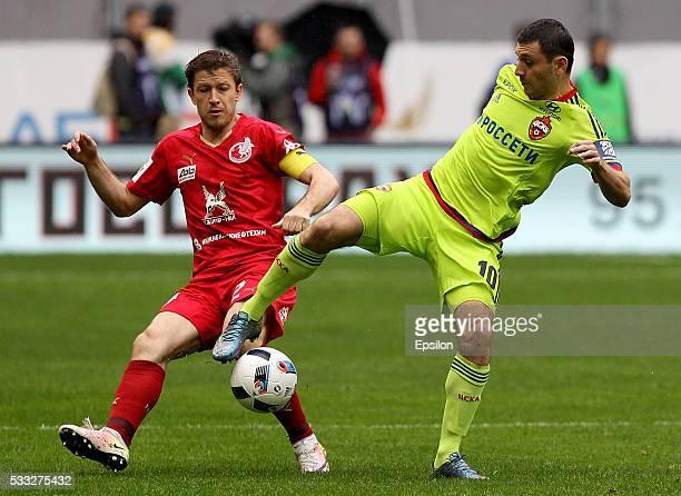 Oleg Kuzmin of FC Rubin Kazan challenged by Alan Dzagoev of FC CSKA Moscow during the Russian Premier League match between FC Rubin Kazan and FC CSKA...