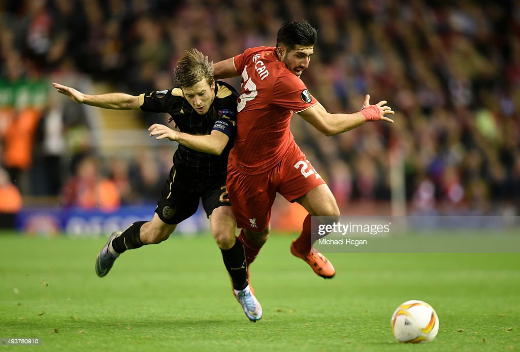 Oleg Kuzmin of Rubin Kazan brings down Emre Can of Liverpool to earn his second booking and red card during the UEFA Europa League Group B match between Liverpool FC and Rubin Kazan at Anfield on October 22, 2015 in Liverpool, United Kingdom.