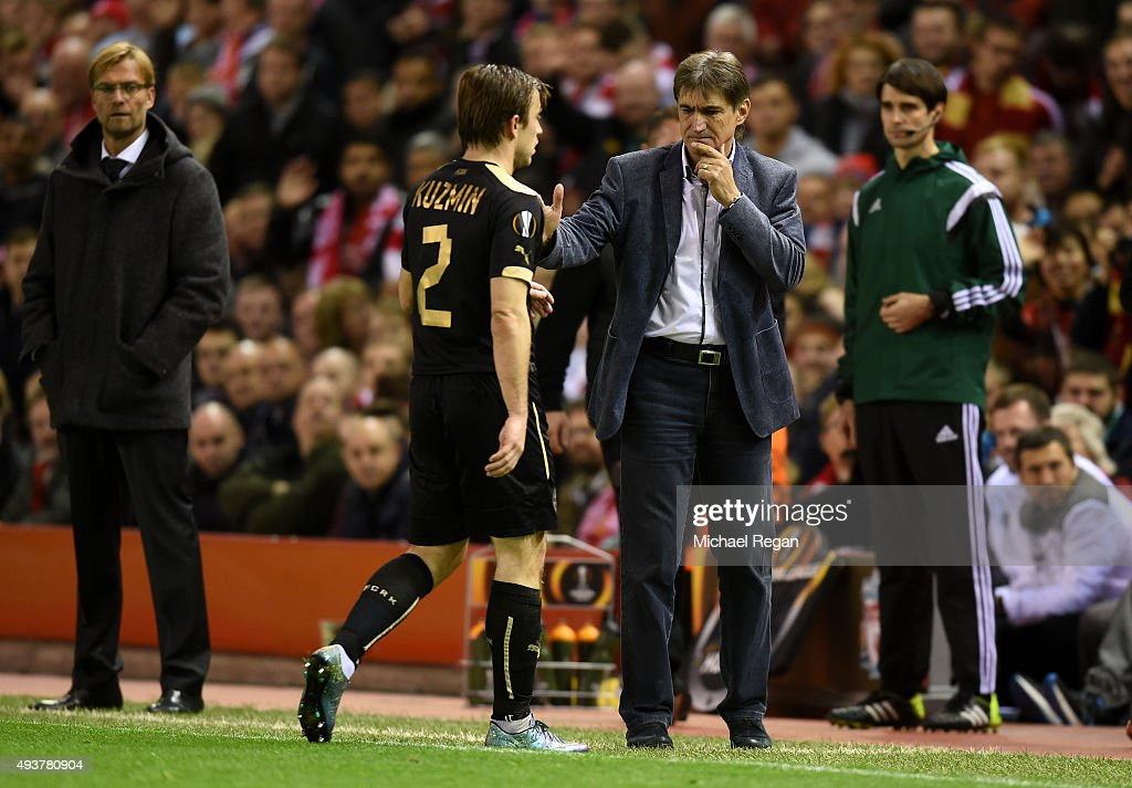 Oleg Kuzmin of Rubin Kazan is consoled by Yuriy Utkulbaev the manager of Rubin Kazan after being sent off for his second bookable offence during the UEFA Europa League Group B match between Liverpool FC and Rubin Kazan at Anfield on October 22, 2015 in Liverpool, United Kingdom.