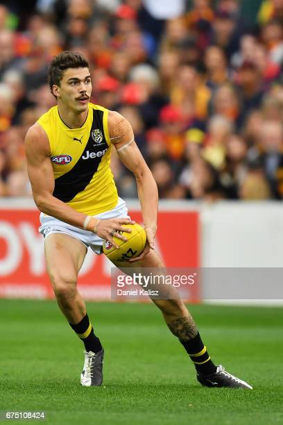 Oleg Markov of the Tigers looks to pass the ball during the round six AFL match between the Adelaide Crows and the Richmond Tigers at Adelaide Oval...