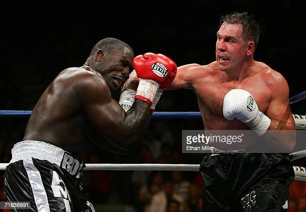 Oleg Maskaev connects on a punch to the head against Hasim Rahman during their WBC World Heavyweight Championship bout August 12 2006 at the Thomas...