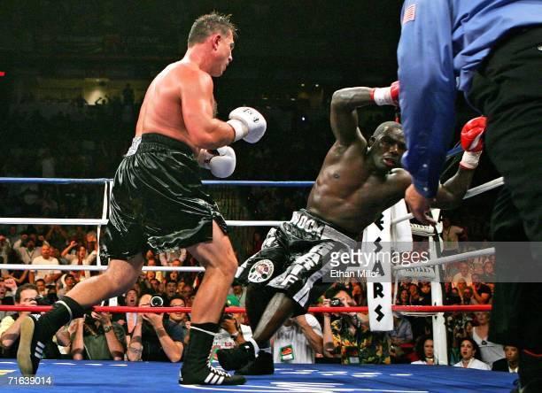 Oleg Maskaev knocks Hasim Rahman down in the 12th round of their WBC world heavyweight championship bout August 12 2006 at the Thomas Mack Center in...