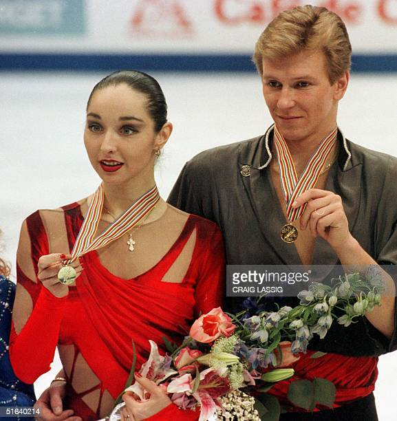 Oleg Ovsyannikov and partner Anjelika Krylova of Russia hold their medals after their performance 03 April in the free dance program at World Figure...