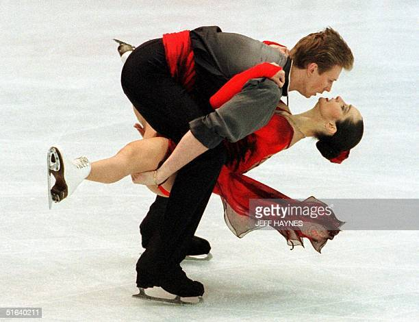 Oleg Ovsyannikov holds partner Anjelika Krylova of Russia between his legs during their performance 03 April in the free dance program at World...