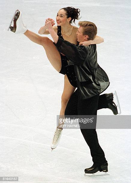 Oleg Ovsyannikov of Russia holds partner Anjelika Krylova as she leaps in the air during the ice dancing original dance 02 April at the World Figure...