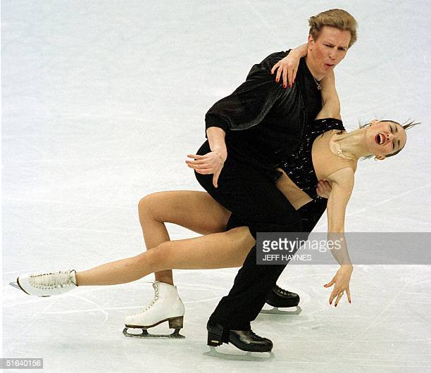 Oleg Ovsyannikov of Russia skates with partner Anjelika Krylova during the ice dancing original dance 02 April during the World Figure Skating...