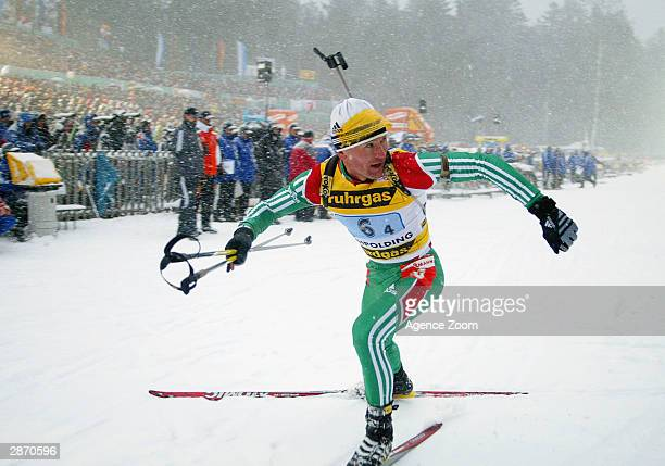 Oleg Ryzhenkov of Belarus celebrates as he crosses the line in the Mens 4x7.5km Relay event at the Biathlon World Cup January 15, 2004 in Ruhpolding,...