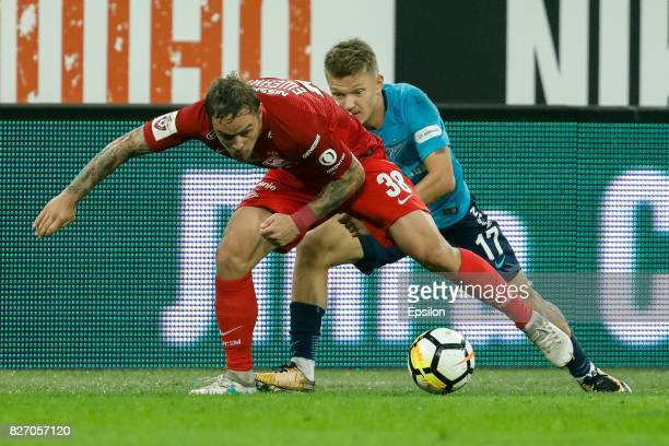 Oleg Shatov of FC Zenit Saint Petersburg and Andrey Yeshchenko of FC Spartak Moscow vie for the ball during the Russian Football League match between...