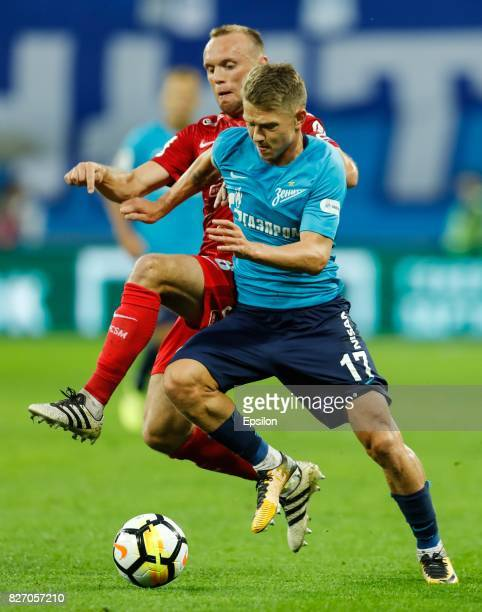 Oleg Shatov of FC Zenit Saint Petersburg and Denis Glushakov of FC Spartak Moscow vie for the ball during the Russian Football League match between...