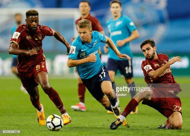 Oleg Shatov of FC Zenit Saint Petersburg vies for the ball with Alex Song and Magomed Ozdoev of FC Rubin Kazan during the Russian Football League...