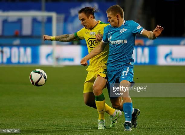 Oleg Shatov of FC Zenit St Petersburg and Andrey Yeshchenko of FC Anzhi Makhachkala vie for the ball during the Russian Football League match between...