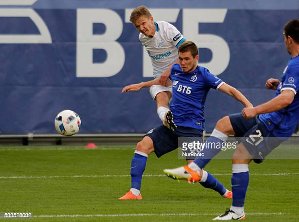 Oleg Shatov of FC Zenit St Petersburg shoots the ball as Aleksandr Tashayev of FC Dynamo Moscow and Fatos Beciraj of FC Dynamo Moscow defend during...