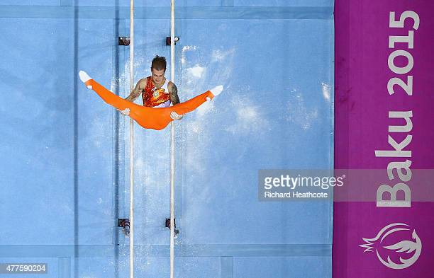 Oleg Stepko of Azerbaijan competes on the Parallel Bars in the Artistic Gymnastics Men's Individual All Round Final during day six of the Baku 2015...