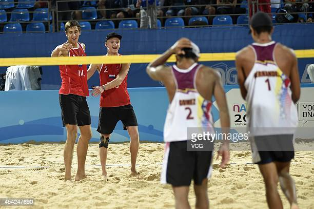 Oleg Stoyanovskiy and Artem Larzutkin of Russia celebrate after beating Jose Gregorio Gomez and Rolando Hernandez of Venezuela in the Men's Beach...
