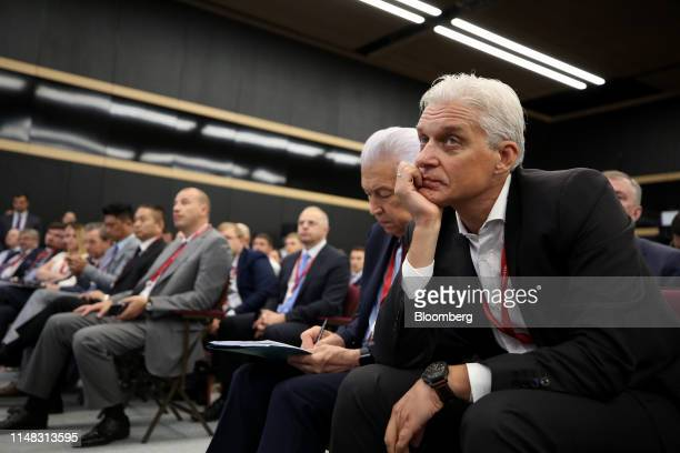 Oleg Tinkoff, chairman of Tinkoff Bank Jsc., watches a panel session at the St. Petersburg International Economic Forum in St. Petersburg, Russia, on...