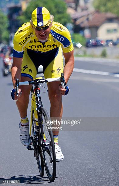 Oleg Tinkov a Russian millionaire and founder of TCS Group Holding Plc rides his bike road bike dressed in the colors of his pro cycling team...