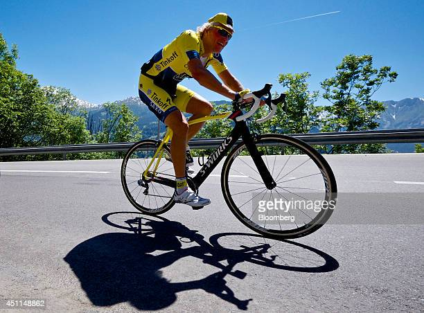 Oleg Tinkov a Russian millionaire and founder of TCS Group Holding Plc rides his bike road bike through the mountains dressed in the colors of his...