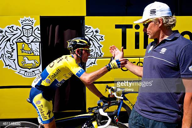 Oleg Tinkov a Russian millionaire and founder of TCS Group Holding Plc congratulates Oliver Zaugg a pro cyclist with TinkoffSaxo after he returns to...