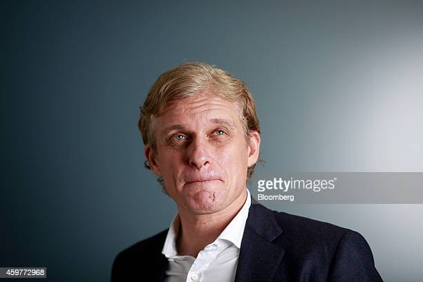 Oleg Tinkov a Russian millionaire and founder of TCS Group Holding Plc poses for a photograph after a Bloomberg Television interview in London UK on...