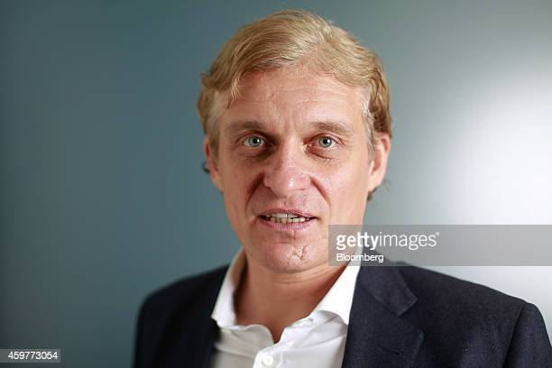 Oleg Tinkov, a Russian millionaire and founder of TCS Group Holding Plc, poses for a photograph after a Bloomberg Television interview in London,...
