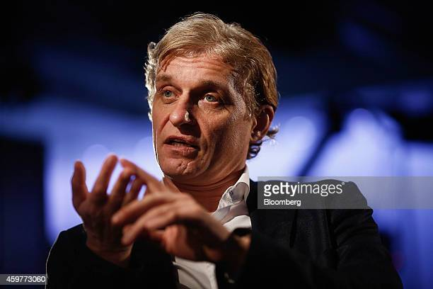 Oleg Tinkov, a Russian millionaire and founder of TCS Group Holding Plc, gestures as he speaks during a Bloomberg Television interview in London,...