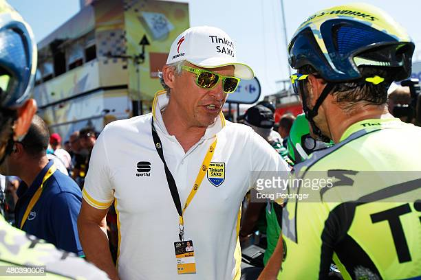 Oleg Tinkov of Tinkov-Saxo talks to his riders during stage eight of the 2015 Tour de France, a 181.5km stage between Rennes and Mur de Bretagne on...