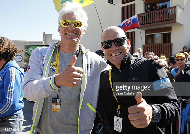 Oleg Tinkov, owner of Team Tinkoff-Saxo congratulates Dave Brailsford, manager of Team Sky following stage twentieth of the 2015 Tour de France, a...