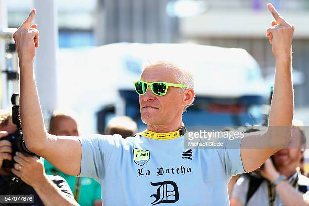 Oleg Tinkov the owner of the Tinkoff team gestures after the stage was won by Peter Sagan of Slovakia and Tinkoff during the 162.5km stage eleven of...