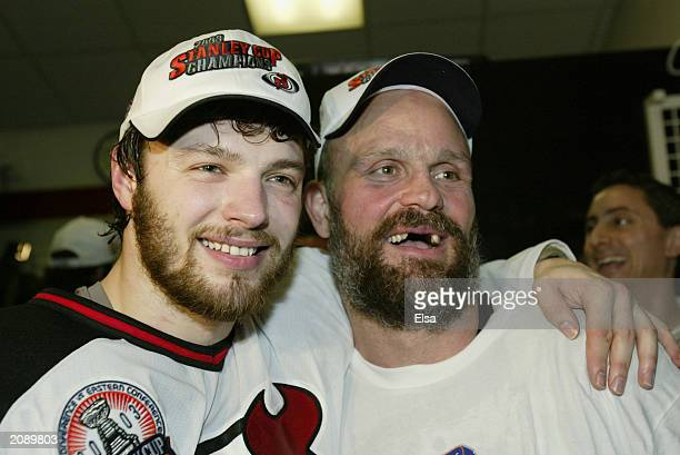 Oleg Tverdovsky and Ken Daneyko of the New Jersey Devils celebrate after defeating the Mighty Ducks of Anaheim 30 in game seven of the 2003 Stanley...