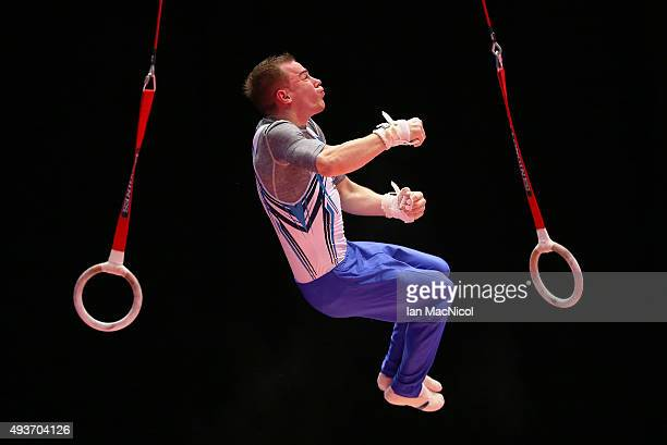 Oleg Verniaiev of Ukraine goes through his routine on the Rings during the 2015 World Artistic Gymnastics Championships Training Session at The SSE...