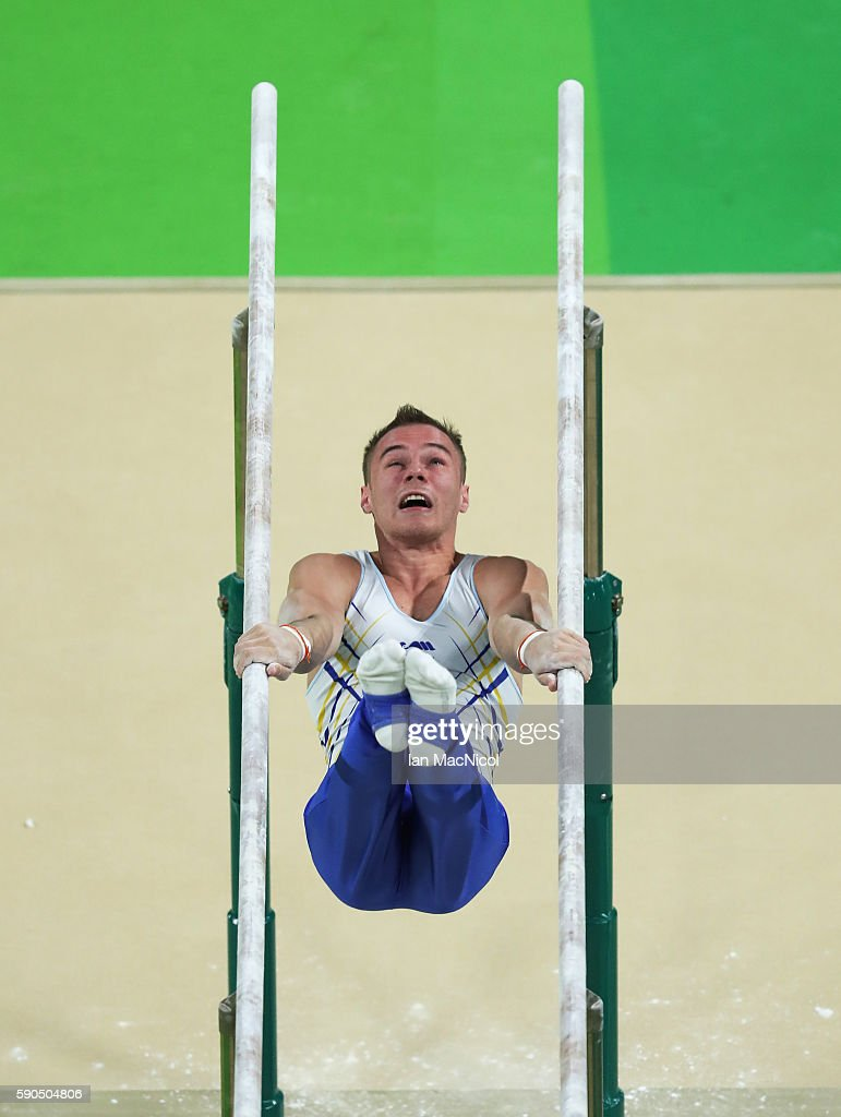 Oleg Verniaiev of Ukraine on his way to winning Gold on the Men's Parallel Bars at Rio Olympic Arena on August 16, 2016 in Rio de Janeiro, Brazil.