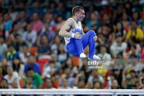 Oleg Verniaiev of Ukraine performs on the Parallel Bars during the Men's Parallel Bars Final on day six of the 45th Artistic Gymnastics World...