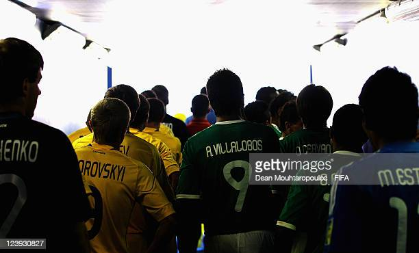 Oleg Zborovskyi of Ukraine and Ricardo Villalobos of Mexico get ready to walk out of the players tunnel for the FIFA Beach Soccer World Cup Group D...