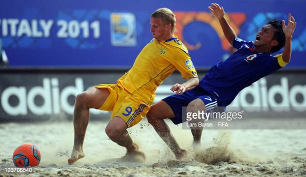 Oleg Zborovskyi of Ukraine challenges Takeshi Kawaharazuka of Japan during the FIFA Beach Soccer World Cup Group D match between Ukraine and Japan at...