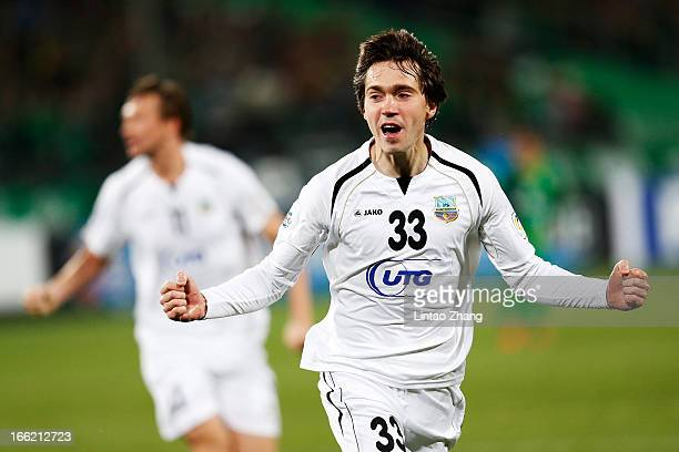 Oleg Zoteev of Bunyodkor celebrates his team's first goal by team mate Fozil Musaev during the AFC Champions League Group match between Bunyodkor and...