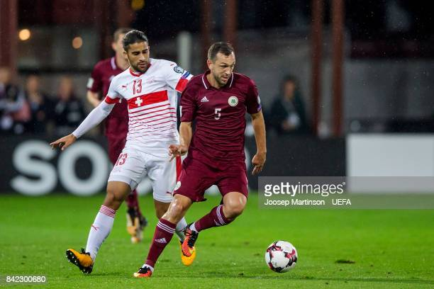 Olegs Laizans of Latvia gets away from Ricardo Rodriguez of Switzerland during the FIFA 2018 World Cup Qualifier between Latvia and Switzerland at...