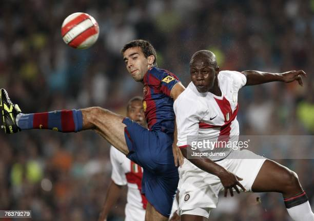Oleguer Presas of Barcelona duels for the ball with Enrique Lopez of Inter Milan during the Gamper Trophy match between Barcelona and Inter Milan at...