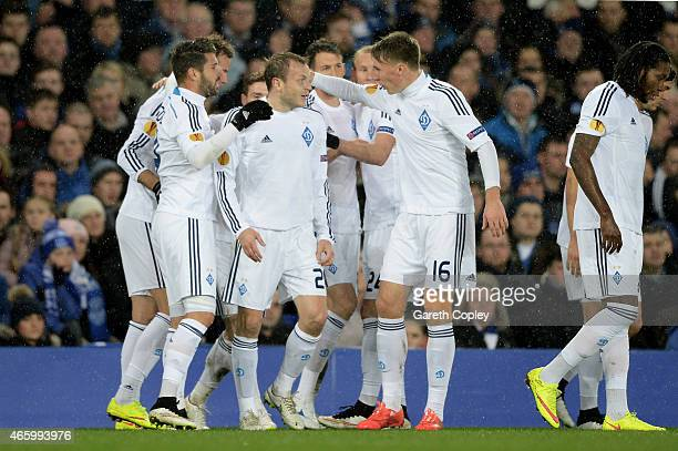 Oleh Husyev of Dynamo Kyiv is congratulated by teammates after scxoring the opening goal during the UEFA Europa League Round of 16 first leg match...