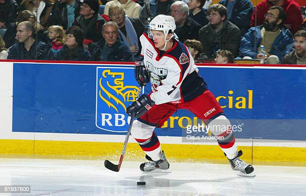 OleKri Tollefsen of the Syracuse Crunch in action against the Hamilton Bulldogs during the American Hockey League game at Copps Coliseum on January 2...