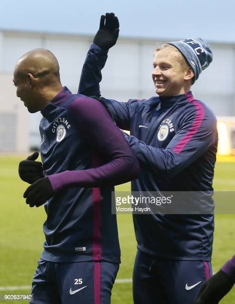 Oleksandar Zinchenko and Fernandinho react during training at Manchester City Football Academy on January 8 2018 in Manchester England