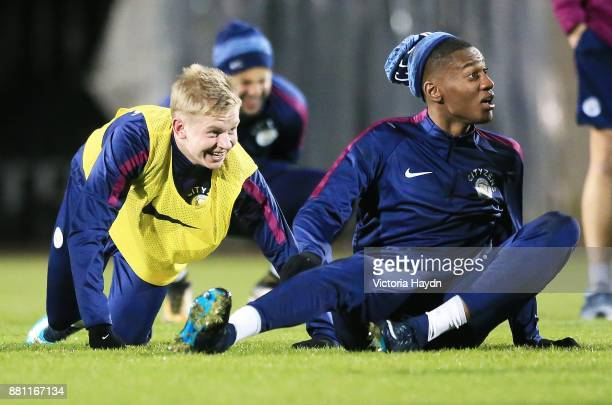 Oleksandar Zinchenko and Tosin Adarabioyo reatcs during training at Manchester City Football Academy on November 28 2017 in Manchester England