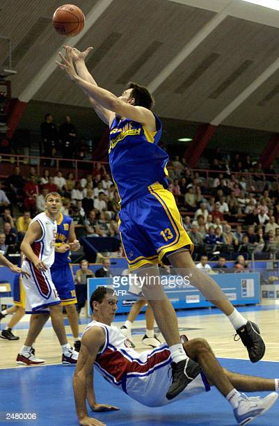 Oleksander Lokmanchuk of Croatia falls while Matej Mamic of Ukraine takes a rebound during their Group D first round match at the European Basketball...