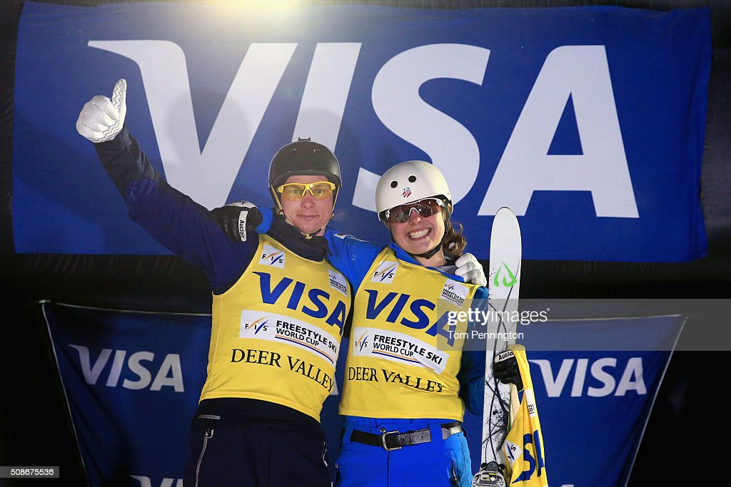 Oleksandr Abramenko of Ukraine and Ashley Caldwell celebrate after winning the overall points leader yellow bib in the men's and ladies' FIS Freestyle Skiing Aerial World Cup at the Visa Freestyle International at Deer Valley on February 5, 2016 in Park City, Utah.