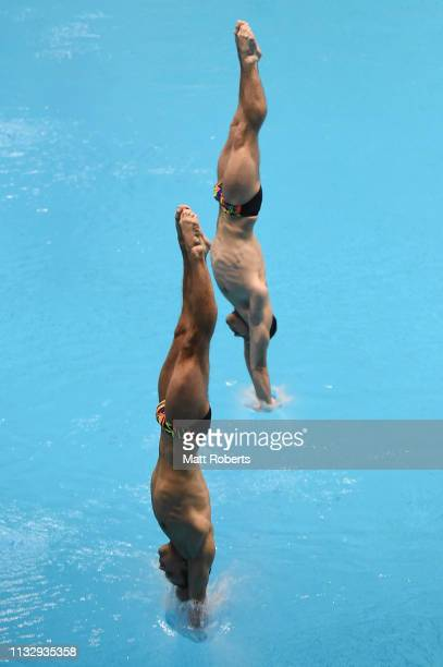Oleksandr Gorshkovozov and Oleg Kolodiy of Ukraine compete during the Men's 3m Synchro Springboard Final on day one of the FINA Diving World Cup...