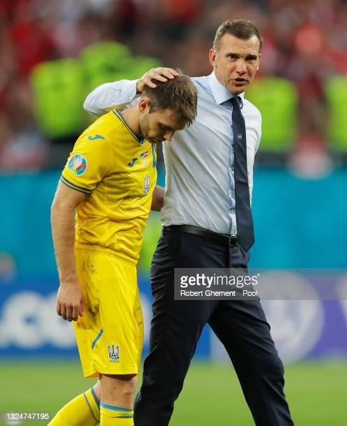 Oleksandr Karavaev of Ukraine looks dejected as he is consoled by Andriy Shevchenko, Head Coach of Ukraine after the UEFA Euro 2020 Championship...