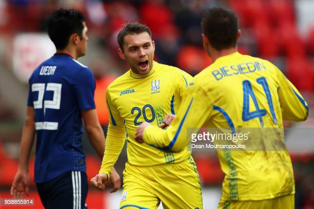 Oleksandr Karavayev of Ukraine celebrates scoring his teams second goal of the game with Artem Besyedin during the International friendly match...