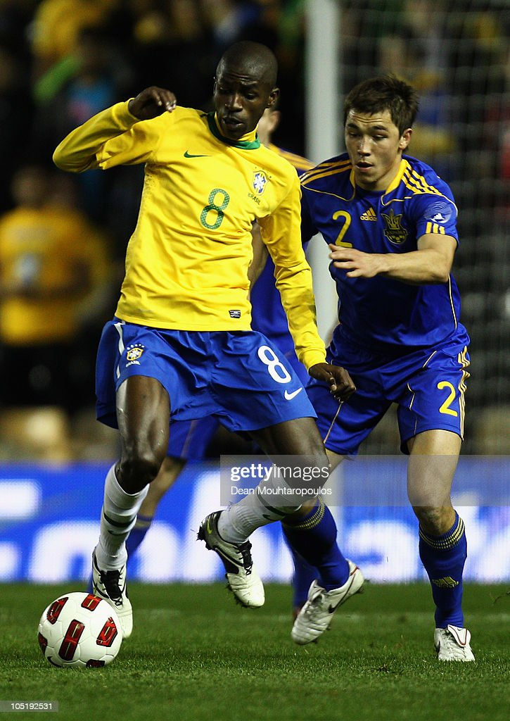 Oleksandr Romanchuk (#2) of Ukraine tackles Ramires of Brazil during the International Friendly match between Brazil and Ukraine at Pride Park Stadium on October 11, 2010 in Derby, England.