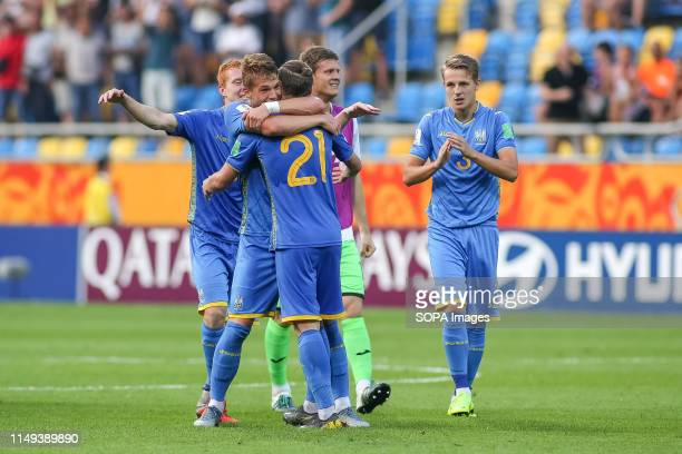 STADIUM GDYNIA POMORSKIE POLAND Oleksandr Safronov Oleksii Kashchuk and Yukhym Konoplia of Ukraine are seen celebrating their victory during the FIFA...